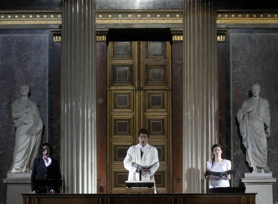 TO GO WITH HOLOCAUST OPERA STORY BY GEORGE JAHN - Katerina Beranova, Robert Holzer and Silke Doerner, from left, perform during the opera 'Spiegelgrund ' by Austrian composer Peter Androsch in the imperial council hall of the Austrian parliament in Vienna, Friday, Jan. 25, 2013. Androsch goes where few others have dared, with an opera depicting how Nazis methodically killed mentally or physically deficient children. The performance premieres to mark International Holocaust Day in the parliament of Austria, a nation still atoning for its role in atrocities committed by the Nazis. (AP Photo/Ronald Zak)