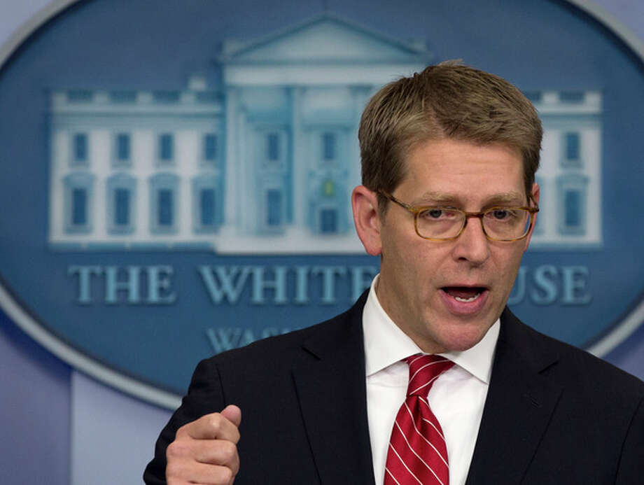 White House press secretary Jay Carney gesture as he speaks during his daily news briefing at the White House in Washington, Wednesday, Jan. 23, 2013. (AP Photo/Carolyn Kaster) / AP
