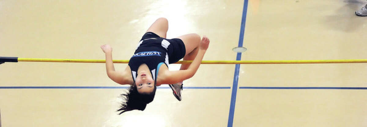 Hour photo/John Nash Katie Ward of Wilton clears the high jump bar at 4-foot-8 during Friday's FCIAC Eastern Division championship meet at Zeoli Field House. Ward finishes second in the event, and was also second in the 45-meter hurdles.