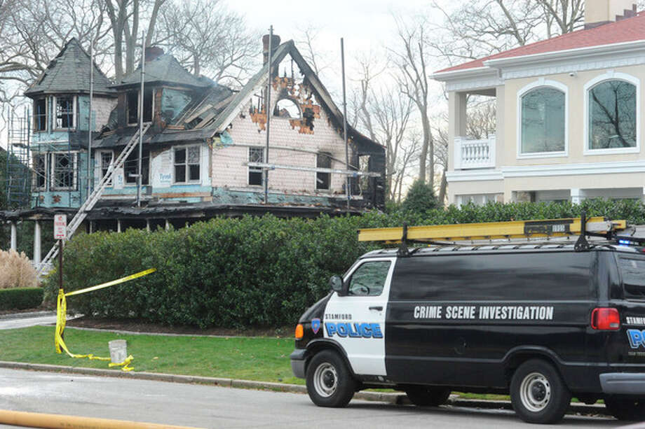 Stamford police outside of a home at 2267 Shippan Avenue in Stamford. The fire broke out at 5:00 am Christmas morning, 5 are reported to have died in the blaze. hour photo/Matthew Vinci / (C)2011, The Hour Newspapers, all rights reserved