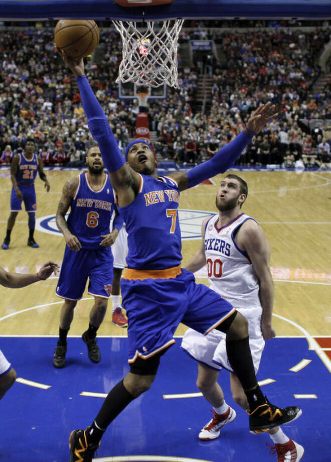 New York Knicks' Carmelo Anthony (7) shoots past Philadelphia 76ers' Spencer Hawes (00) during the first half of an NBA basketball game on Saturday, Jan. 26, 2013, in Philadelphia. (AP Photo/Matt Slocum)