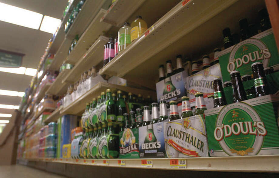 The beverage aisle of Village Market in Wilton. There is a petition to sell beer in grocery stores on the Nov. 8 ballot. Hour photo / Erik TrautmannHour photo / Erik Trautmann / (C)2011, The Hour Newspapers, all rights reserved