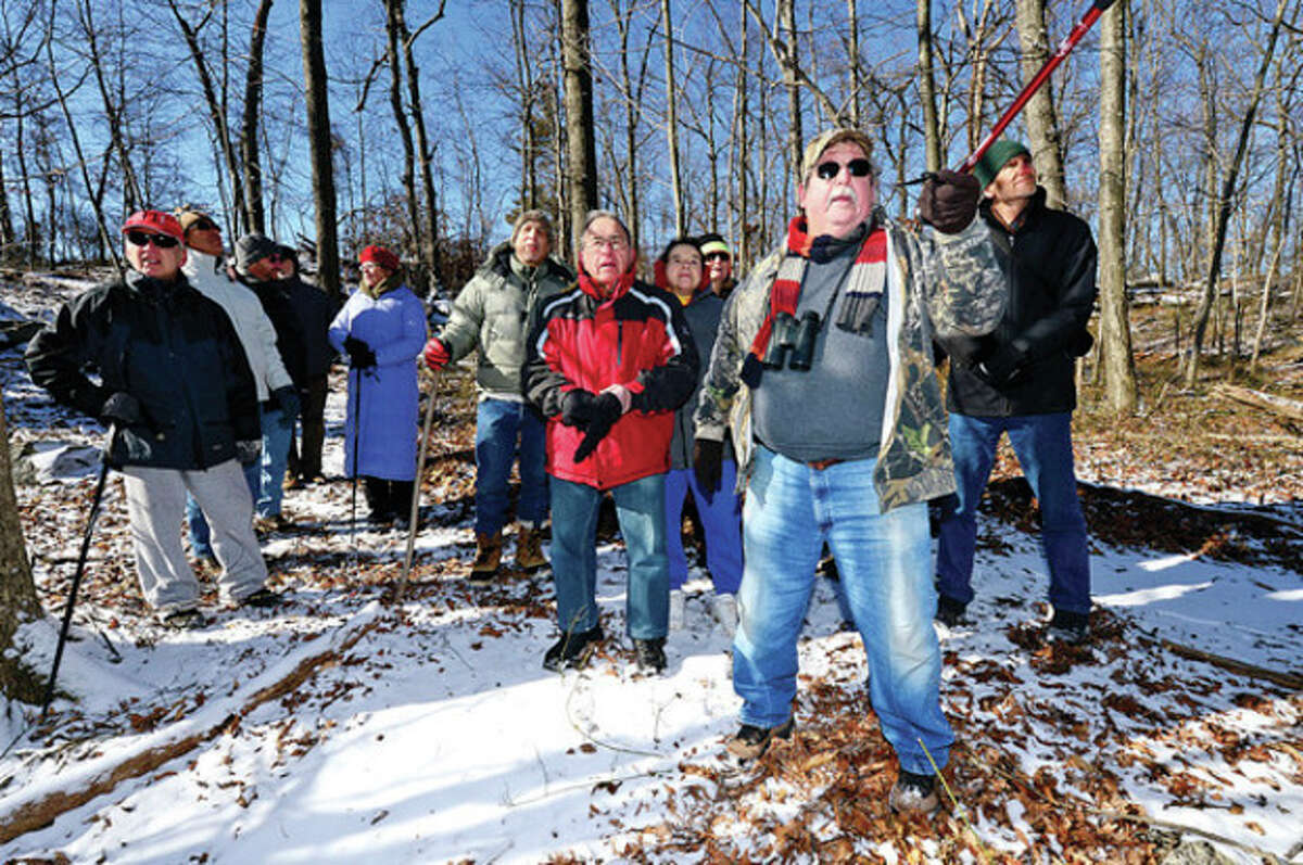 """Master Conservationist for ther CT DEP Division of Wildlife, Larry Flynn, leads the Friends of Oak Hills Park """"Winter Walk in the Woods"""" Saturday morning viewing the woodland area of the park and talking about the wildlife that live there. Hour photo / Erik Trautmann"""