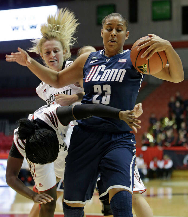 Connecticut forward Kaleena Mosqueda-Lewis (23) pulls a rebound away from Cincinnati guard Dayeesha Hollins, left, while guard Kayla Cook watches in the first half of an NCAA college basketball game on Saturday, Jan. 26, 2013, in Cincinnati. (AP Photo/Al Behrman) / AP