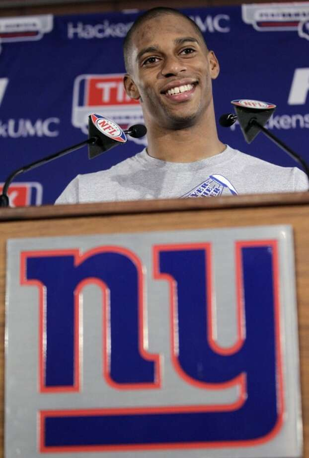 New York Giants wide receiver Victor Cruz talks to the media after NFL football practice, Thursday, Jan. 26, 2012, in East Rutherford, N.J. The Giants will face the New England Patriots in the Super Bowl on Feb. 5 in Indianapolis. (AP Photo/Julio Cortez)