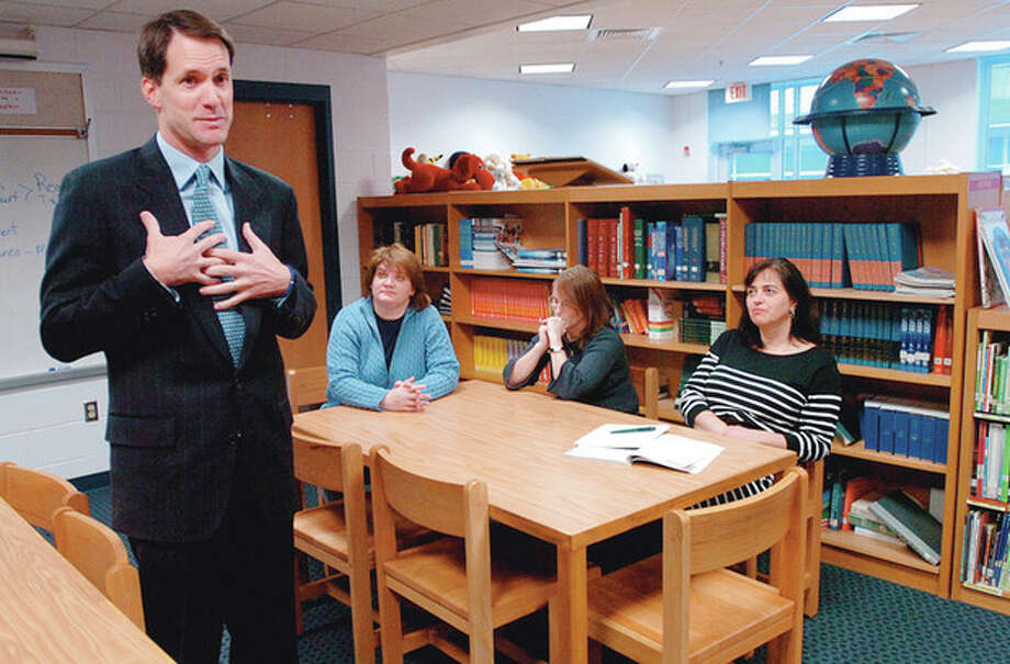 Congressman Jim Himes talks to teachers and administrators while visiting Kendall Elementary School in Norwalk Tuesday to tour the classrooms and discuss ways to improve federal intiatives like Head Sart and No Child Left Behind. Hour photo / Erik Trautmann / (C)2011, The Hour Newspapers, all rights reserved