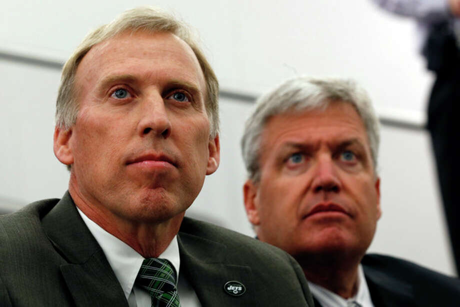 John Idzik, left, sits next to New York Jets head coach Rex Ryan while waiting to be introduced as the Jets new general manager during an NFL football news conference, Thursday, Jan. 24, 2013, in Florham Park , N.J. (AP Photo/Julio Cortez) / AP