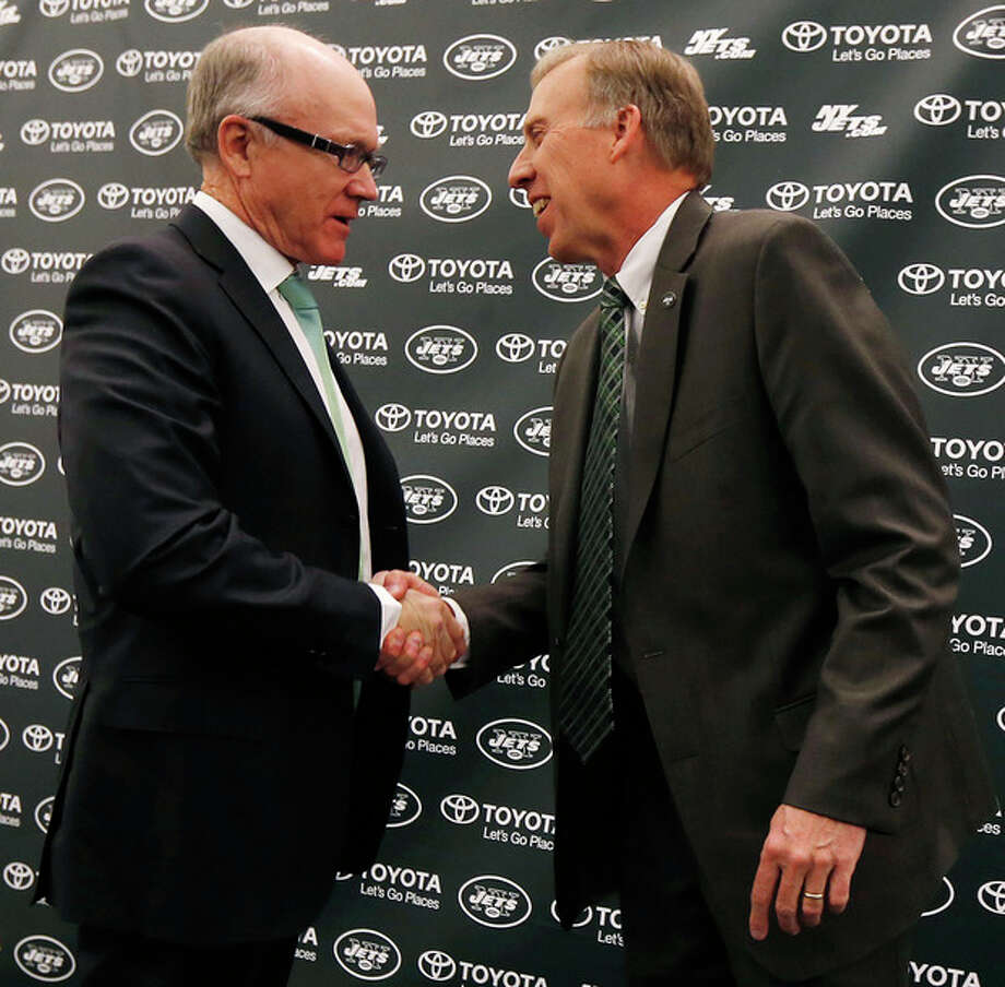 New York Jets owner Woody Johnson, left, shakes hands with the team's new general manager John Idzik during an NFL football news conference, Thursday, Jan. 24, 2013, in Florham Park, N.J. (AP Photo/Julio Cortez) / AP