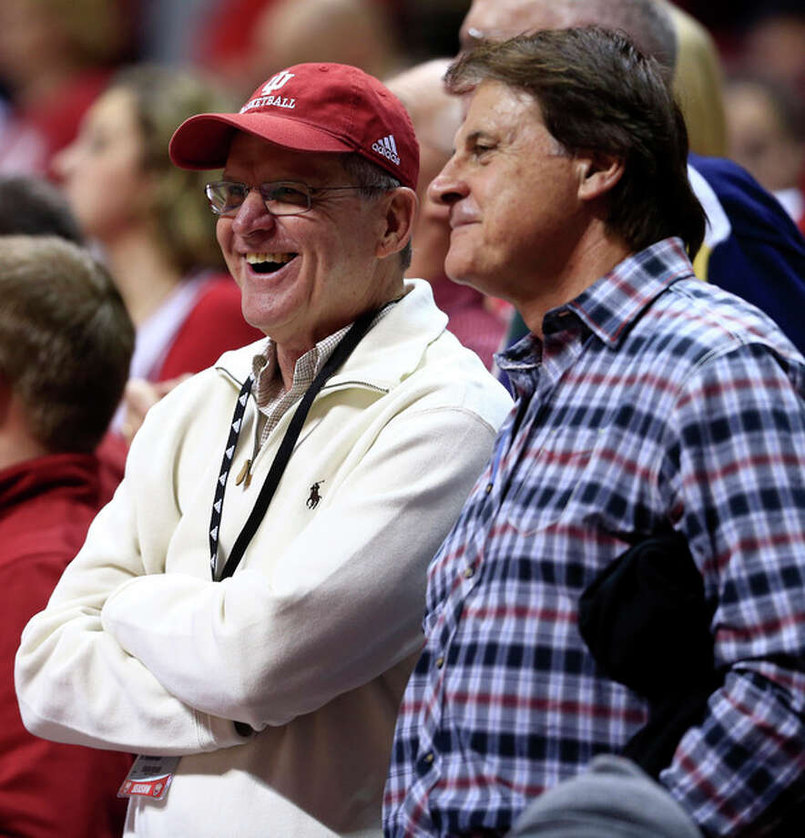 Jack Harbaugh, left, talks with former St. Louis Cardinals manager Tony La Russa during the second half of an NCAA college basketball game between Indiana and Penn State, Wednesday, Jan. 23, 2013, in Bloomington, Ind. Indiana won 72-49. Harbaugh, a former college football player and coach, is the father of Jim and John Harbaugh, the head coaches of the San Francisco 49ers and the Baltimore Ravens NFL football teams respectively. The 49ers and the Ravens are scheduled to play in Super Bowl XLVII in New Orleans on Sunday, Feb. 3. (AP Photo/Darron Cummings) / AP