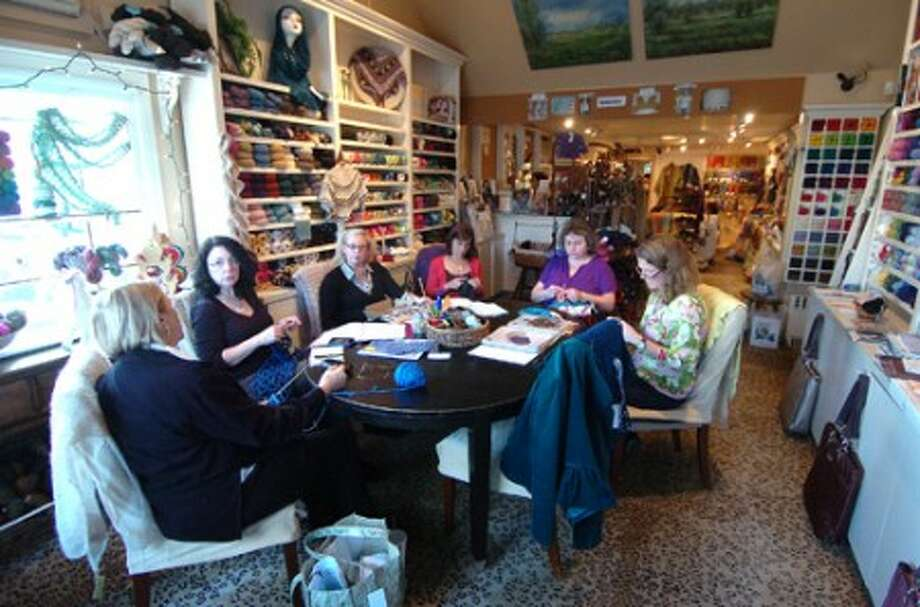 Photo/Alex von Kleydorff. A round table discussion with all the employees on what to offer for the summer knitting classes at Westport yarns.