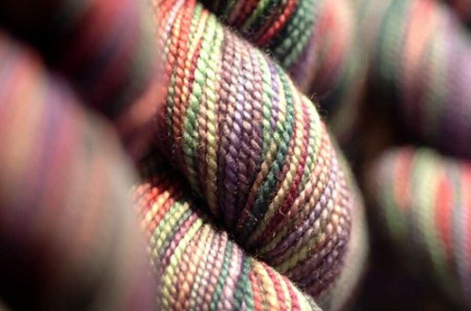 Photo/Alex von Kleydorff. Detail of a skein of hand dyed Canadian Koigu yarn at Westport yarns.