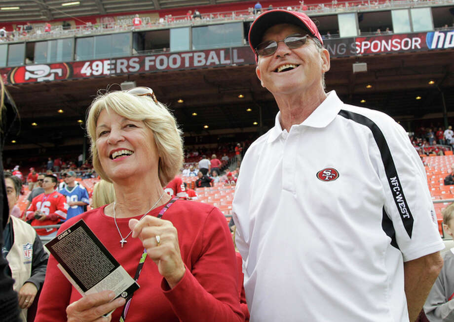 FILE- In this Sept. 11, 2011 file photo, Jackie and Jack Harbaugh, parents of San Francisco 49ers coach Jim Harbaugh and Baltimore Ravens coach John Harbaugh, stand before an NFL football game between the 49ers and the Seattle Seahawks in San Francisco. The entire Harbaugh family already got its Super Bowl victory last Sunday, when each coach did his part to ensure a family reunion in New Orleans next week. The Ravens face off against the 49ers in the first Super Bowl coached by siblings on opposite sidelines. (AP Photo/Paul Sakuma, file) / AP