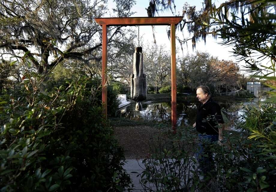 People walk through the Sydney Walda Besthoff Sculpture Garden in City Park in New Orleans, Tuesday, Jan. 15, 2013. The New Orleans Museum of Art is located in the park, and while there's a fee to enter the museum, just beyond the museum are dozens of art objects you can see for free in the Sydney and Walda Besthoff Sculpture Garden. The sculptures, valued at more than $25 million, can be viewed in a relaxing setting that includes meandering footpaths, pedestrian bridges and reflecting lagoons. (AP Photo/Gerald Herbert) / AP