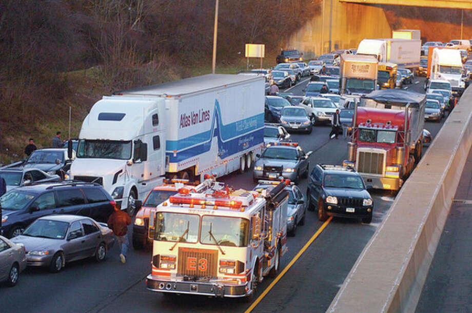 I-95 Southbound was closed following the rollover of a truck where the driver as pinned in the cab between exits 14 and 13 Wednesday afternoon. Hour photo / Erik Trautmann / (C)2011, The Hour Newspapers, all rights reserved