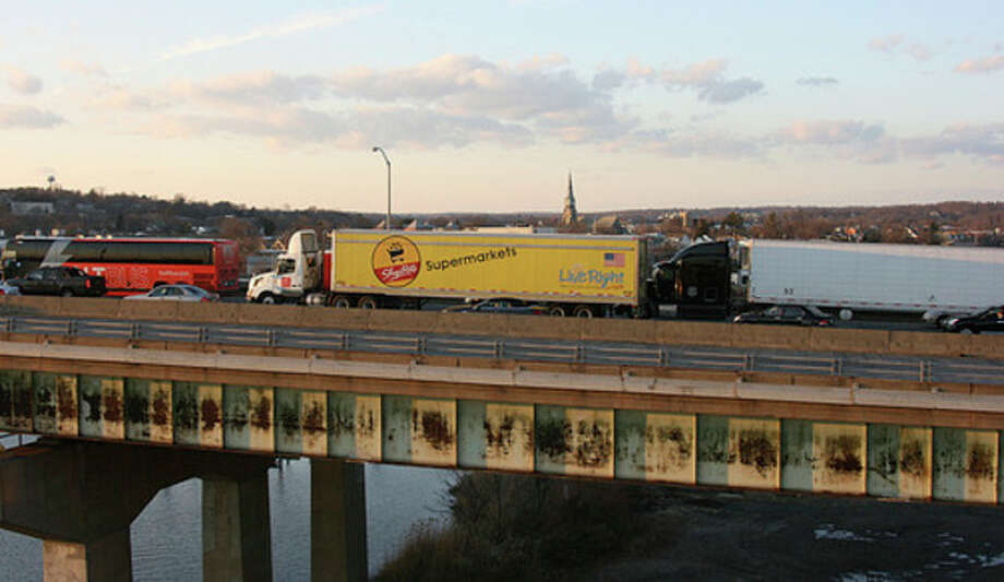 Hour photo/CHRIS BOSAK South-bound I-95 traffic is stopped on the Yankee Doodle Bridge in the wake of an accident Wednesday evening.