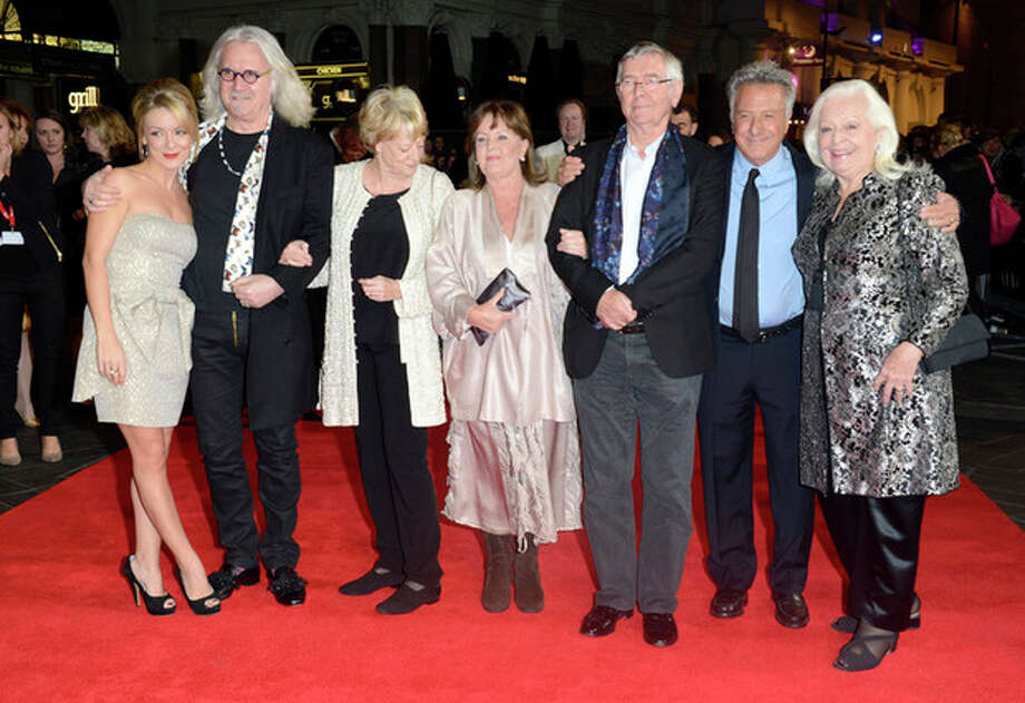 "FILE - In this Oct. 15, 2012 file photo, from left, Sheridan Smith, Billy Connolly, Dame Maggie Smith, Pauline Collins, Tom Courtenay, Dustin Hoffman and Dame Gwyneth Jones pose at the London Film Festival American Airlines Gala -Quartet at Odeon West End, in London. The 75-year-old Hoffman went behind the camera for ""Quartet,"" starring Smith, Courtenay, Connolly and Collins as aging British opera divas at a retirement home for musicians who put aside past differences for a reunion concert. (Photo by Jon Furniss/Invision, File) / Invision"