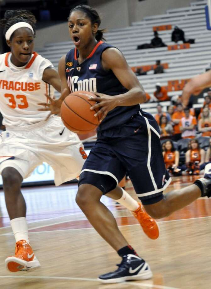 Connecticut's Tiffany Hayes drives against Syracuse's Phylesha Bullard, left, during the first half of an NCAA college basketball game in Syracuse, N.Y., Wednesday, Jan. 25, 2012. (AP Photo/Kevin Rivoli)
