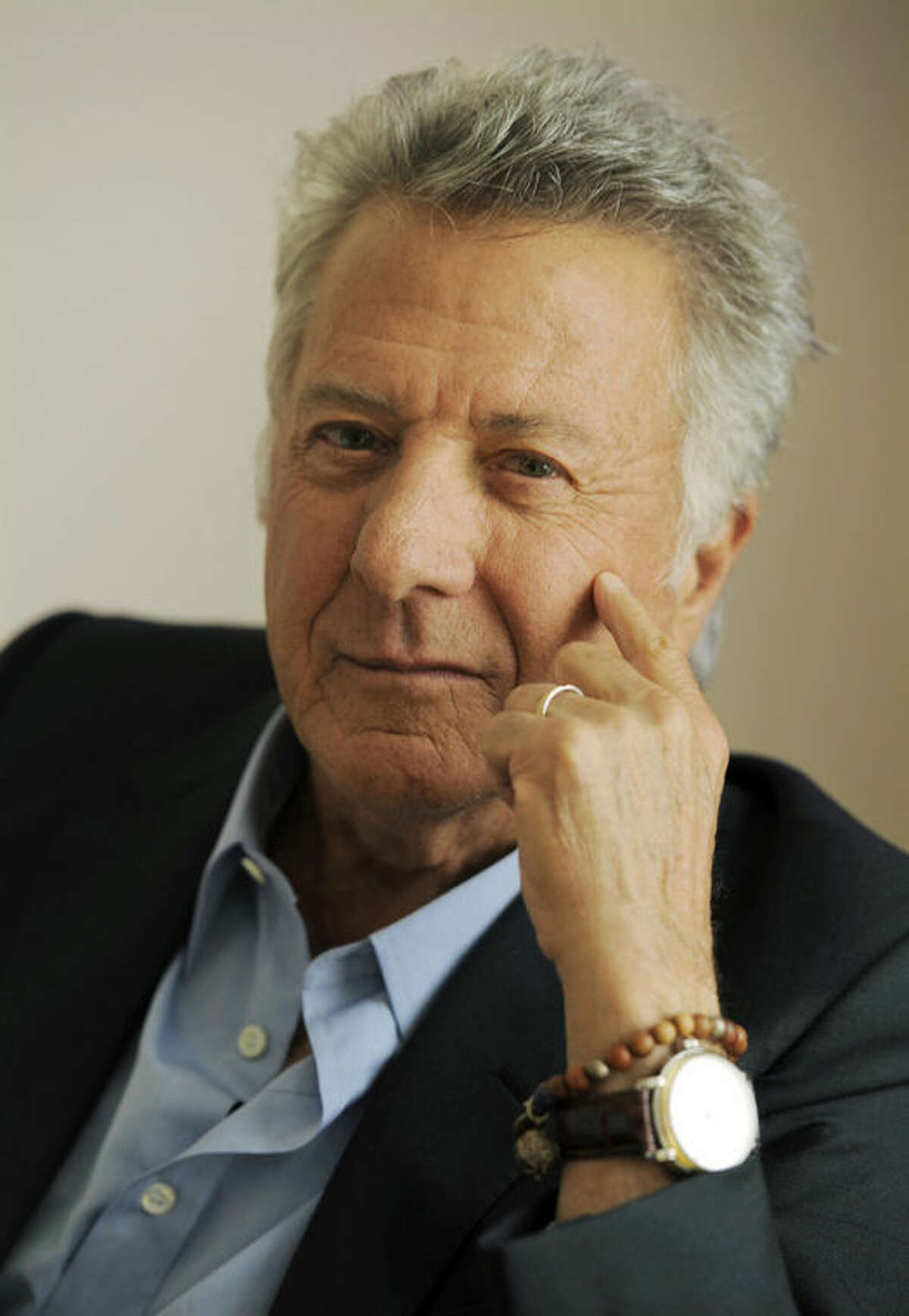 """FILE - In this Sept. 10, 2012 file photo, Dustin Hoffman, director of the film """"Quartet,"""" poses for a portrait at the 2012 Toronto Film Festival, in Toronto. ?""""Quartet,?"""" which premiered at last September's Toronto International Film Festival, opened in a handful of theaters Jan. 11, 2013, and expands to wider release Friday. (Photo by Chris Pizzello/Invision/AP, File)"""