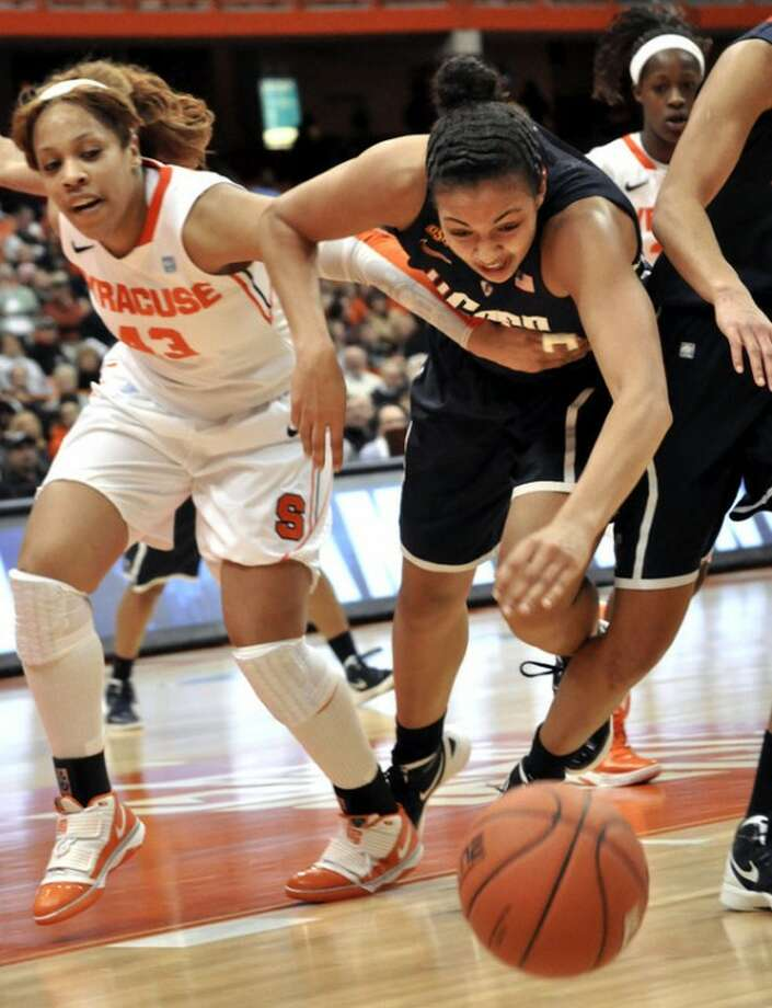 Connecticut's Kiah Stokes, right, and Syracuse's Iasia Hemingway race for the ball during the first half of an NCAA college basketball game in Syracuse, N.Y., Wednesday, Jan. 25, 2012. (AP Photo/Kevin Rivoli)