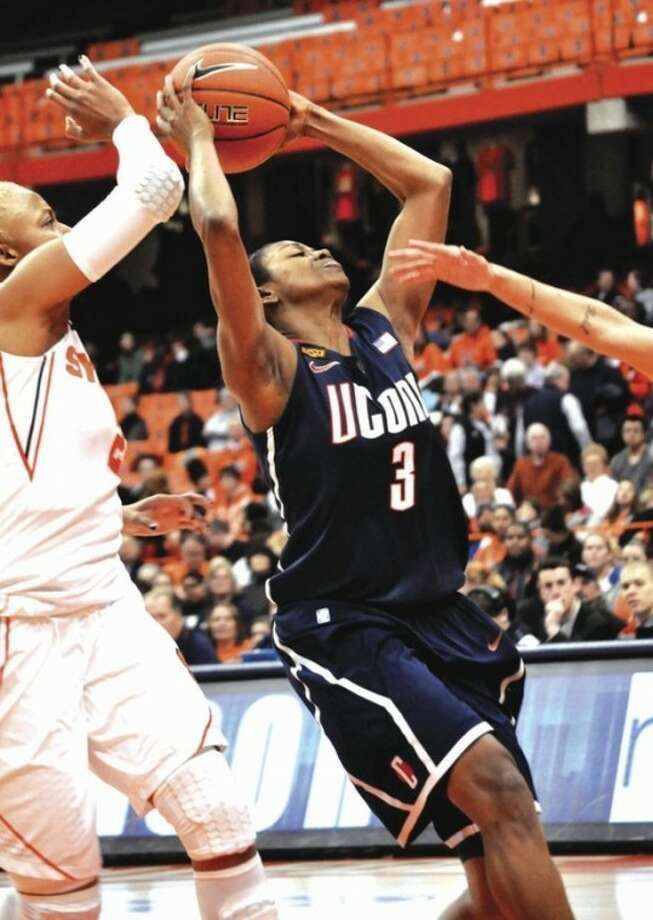 UConn's Tiffany Hayes drives to the basket against Syracuse's Elashier Hall, left, during the second half of Wednesday night's game. Not much got in Hayes' way. She scored a career-high 35 points in a 95-54 UConn win. AP photo