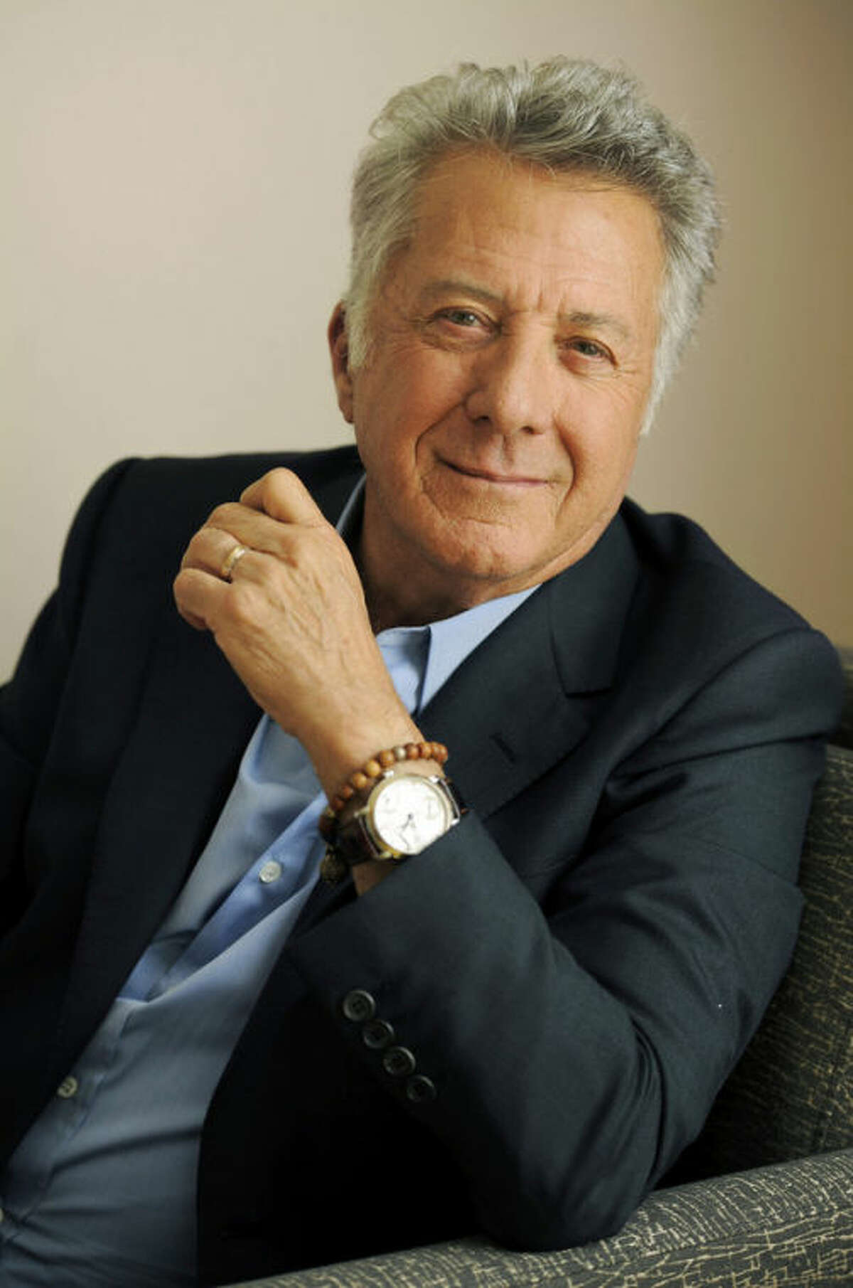 """FILE - In this Sept. 10, 2012 file photo, Dustin Hoffman, director of the film """"Quartet,"""" poses for a portrait at the 2012 Toronto Film Festival, in Toronto. The 75-year-old Hoffman went behind the camera for ?""""Quartet,?"""" starring Maggie Smith, Tom Courtenay, Billy Connolly and Pauline Collins as aging British opera divas at a retirement home for musicians who put aside past differences for a reunion concert. (Photo by Chris Pizzello/Invision/AP, File)"""