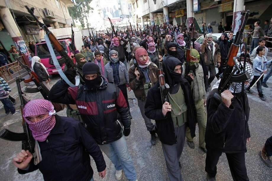 Syrian rebels march in a show of strength during a demonstration in Idlib, Syria, Friday, Feb. 10, 2012. (AP Photo) / AP