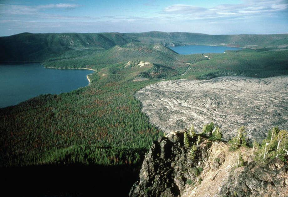 This Aug. 20, 1985 photo from the U.S. Geological Survey shows the Paulina Lakes and the Big Obsidian Flow within the caldera of Newberry Volcano, located on the Newberry Volcanic National Monument about 20 miles south of Bend, Ore. Hot rocks remaining beneath the surface of the flanks of the volcano outside the monument have drawn two companies trying to demonstrate new technology that could greatly expand development of geothermal energy. The project is backed by the federal government and Google. (AP Photo/U.S. Geological Survey/Lyn Topinka) / AP 2012