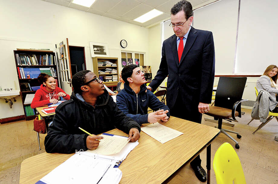CT Governor Dannel Malloy talks with students Joey Ferraro and Kyle Lors durin his visit to Briggs High School in Norwalk Friday to discuss the 2012 education reform package, the Commissioner's Network, that aims to turnaround some of the lowest performing schools in the state in order to help thousands of students receive a quality education and close the achievement gap. Hour photo / Erik Trautmann / (C)2012, The Hour Newspapers, all rights reserved