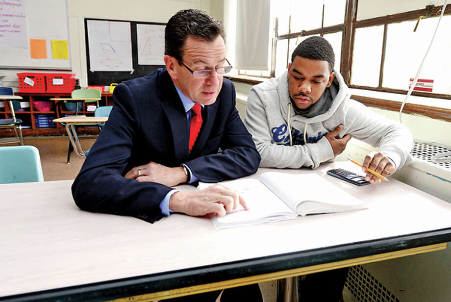 CT Governor Dannel Malloy sits with Briggs High School student Willie Junes during the governor's visit to Briggs High School in Norwalk Friday to discuss 2012 education reform package, the Commissioner's Network, that aims to turnaround some of the lowest performing schools in the state in order to help thousands of students receive a quality education and close the achievement gap. Hour photo / Erik Trautmann / (C)2012, The Hour Newspapers, all rights reserved