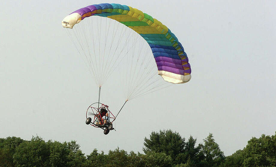 Hour Photo/Alex von Kleydorff. Rich Ruggles makes a turn high above Wilton in his Powered Parachute / 2011 The Hour Newspapers