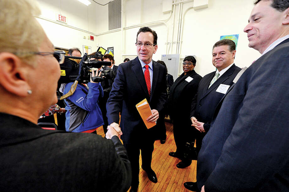 CT Governor Dannel Malloy visits with dignitaries at Briggs High School in Norwalk Friday to discuss the 2012 education reform package, the Commissioner's Network, that aims to turnaround some of the lowest performing schools in the state in order to help thousands of students receive a quality education and close the achievement gap. Hour photo / Erik Trautmann / (C)2012, The Hour Newspapers, all rights reserved