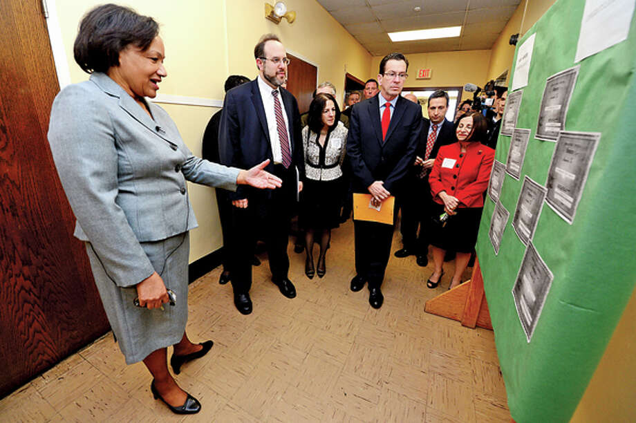 Briggs High School principal Dr Marie Allen leads a tour for CT Governor Dannel Malloy, right and CT Education Commissioner Stefan Pryor during a visit to discuss the 2012 education reform package, the Commissioner's Network, that aims to turnaround some of the lowest performing schools in the state in order to help thousands of students receive a quality education and close the achievement gap. Hour photo / Erik Trautmann / (C)2012, The Hour Newspapers, all rights reserved