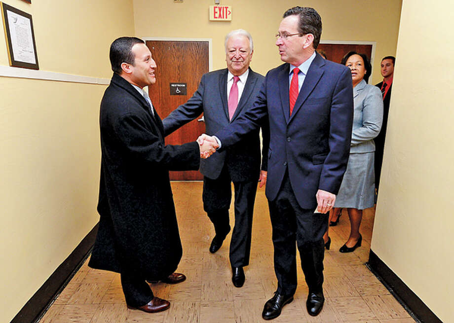 CT Governor Dannel Malloy is greetd by Norwalk Councilman Warren Pena and mayor Richard Moccia during a visit by the governor to Briggs High School in Norwalk Friday to discuss the 2012 education reform package, the Commissioner's Network, that aims to turnaround some of the lowest performing schools in the state in order to help thousands of students receive a quality education and close the achievement gap. Hour photo / Erik Trautmann / (C)2012, The Hour Newspapers, all rights reserved
