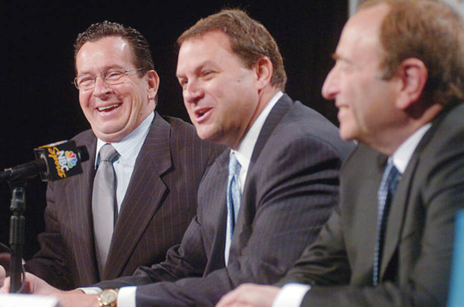 CT Governor Danell Malloy reacts to NBC Sports Group chairman Mark Lazarus and NHL Commssioner Gary Bettman listen in during a press confrence announcing that NBC Sports will be moving to Stamford Tuesday. Hour photo / Erik Trautmann / (C)2011, The Hour Newspapers, all rights reserved