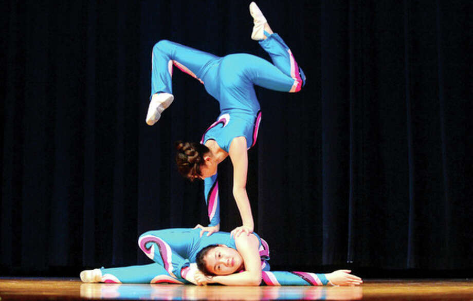 All Saints Catholic School hosted the Chinese Acrobat troupe from Bejing as part of the cultural enrichment program and to help kick off National Catholic Schools week Thursday morning.Hour photo / Erik Trautmann / (C)2012, The Hour Newspapers, all rights reserved