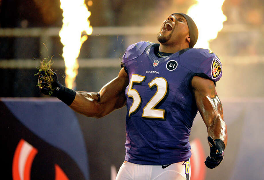 FILE - In this Sept. 23, 2012, file photo, Baltimore Ravens linebacker Ray Lewis reacts as he is introduced before an NFL football game against the New England Patriots in Baltimore. Ravens fans will rock the building during Ray Lewis' pregame Squirrel Dance, a YouTube sensation that Lewis will perform for the final time before retiring. Will there be smoke and flames to accompany the star linebacker's ritual? (AP Photo/Nick Wass, File) / A2012