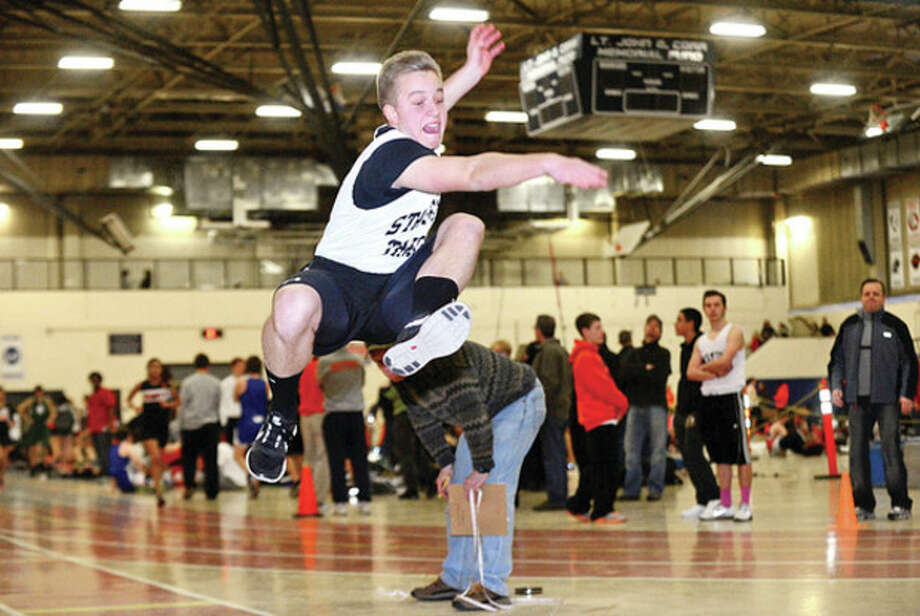 SHS' Filip Szostek competes in the long jump during the indoor track meet in Wilton Saturday.Hour photo / Erik Trautmann / (C)2012, The Hour Newspapers, all rights reserved