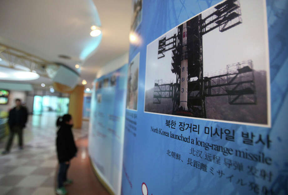 """A picture of a North Korean rocket Unha is displayed at a unification observation post in Paju near the demilitarized zone (DMZ) of Panmunjom, South Korea, Sunday, Jan. 27, 2013. Kim convened top security and foreign affairs officials and ordered them to take """"substantial and high-profile important state measures,"""" state media said Sunday, indicating that he plans to push forward with a threat to explode a nuclear device in defiance of the United Nations. (AP Photo/Ahn Young-joon) / AP"""