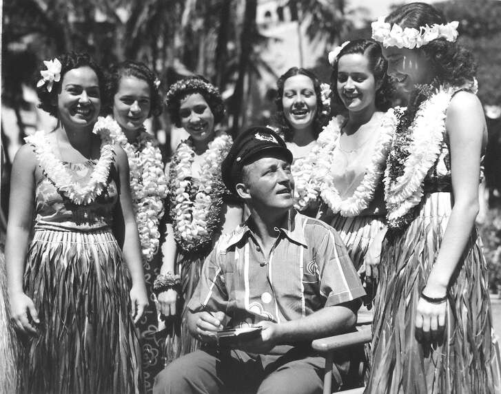 At Waikiki�s Royal Hawaiian Hotel in 1936, Bing Crosby wears a three-button pullover shirt made from fabric printed with Japanese motifs. Bing was a great promoter of aloha shirts, bringing them back to the mainland after his first visit to the Territory. Courtesy of the Bishop Archives