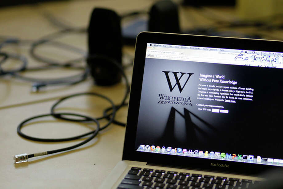 "A blackout landing page is displayed on a laptop computer screen inside the ""Anti-Sopa War Room"" at the offices of the Wikipedia Foundation in San Francisco, Wednesday, Jan. 18, 2012. January 18 is a date that will live in ignorance, as Wikipedia started a 24-hour blackout of its English-language articles, joining other sites in a protest of pending U.S. legislation aimed at shutting down sites that share pirated movies and other content. The Internet companies are concerned that the Stop Online Piracy Act in the House and the Protect Intellectual Property Act under consideration in the Senate, if passed, could be used to target legitimate sites where users share content. (AP Photo/Eric Risberg) / AP"