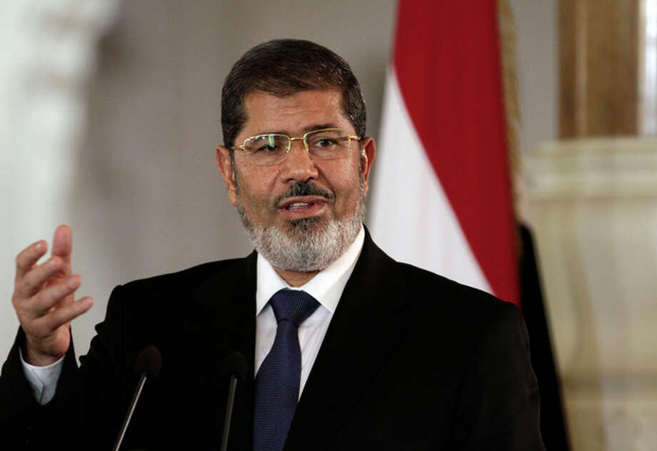 FILE - In this July 13, 2012 file photo, Egyptian President Mohammed Morsi speaks to reporters at the Presidential palace in Cairo. President Barack Obama begins his second term straining to maintain a good relationship with Egypt, an important U.S. ally whose president is a conservative Islamist walking a fine line between acting as a moderate peace broker and keeping his Muslim Brotherhood party happy with anti-American rhetoric. The White House last summer had hoped to smooth over some of the traditional tensions between Washington and the Brotherhood, a party rooted in opposition to Israel and the U.S., when Egypt overthrew dictator Hosni Mubarak and picked Morsi as its first democratically-elected leader. (AP Photo/Maya Alleruzzo, File) / AP