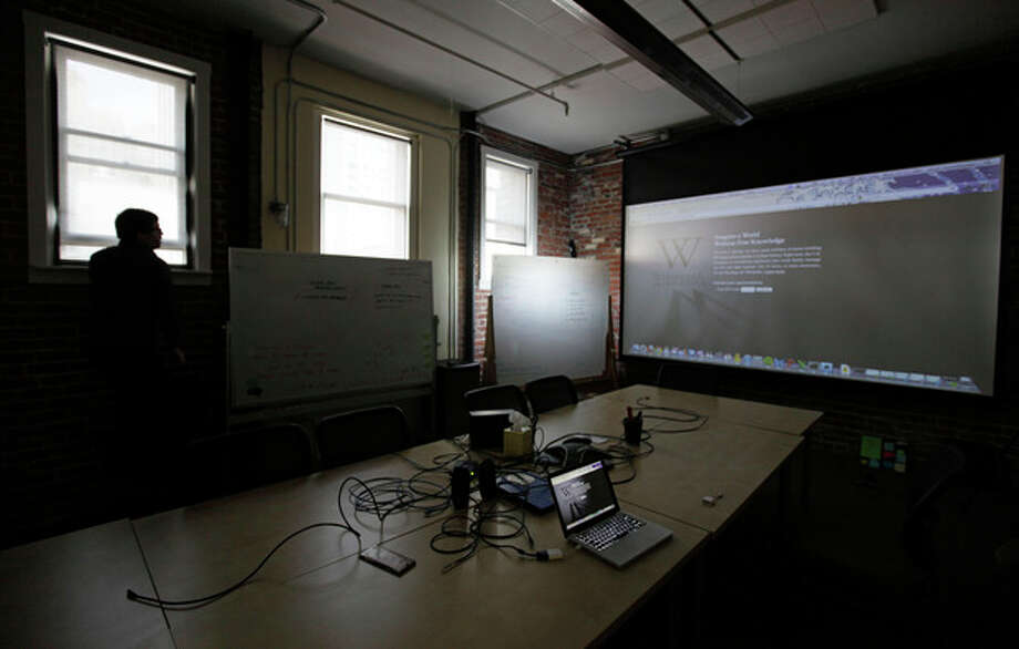 "Josh Van Davier looks at a projected blackout landing page inside the ""Anti-Sopa War Room"" at the offices of the Wikipedia Foundation in San Francisco, Wednesday, Jan. 18, 2012. January 18 is a date that will live in ignorance, as Wikipedia started a 24-hour blackout of its English-language articles, joining other sites in a protest of pending U.S. legislation aimed at shutting down sites that share pirated movies and other content. The Internet companies are concerned that the Stop Online Piracy Act in the House and the Protect Intellectual Property Act under consideration in the Senate, if passed, could be used to target legitimate sites where users share content. (AP Photo/Eric Risberg) / AP"