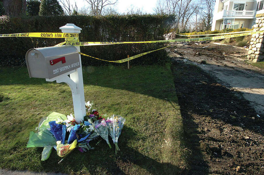 Hour Photo/ Alex von Kleydorff. Flowers placed at the base of the mailbox for 2267 Shippan Ave where a fatal fire killed five people Christmas Day. / 2011 The Hour Newspapers