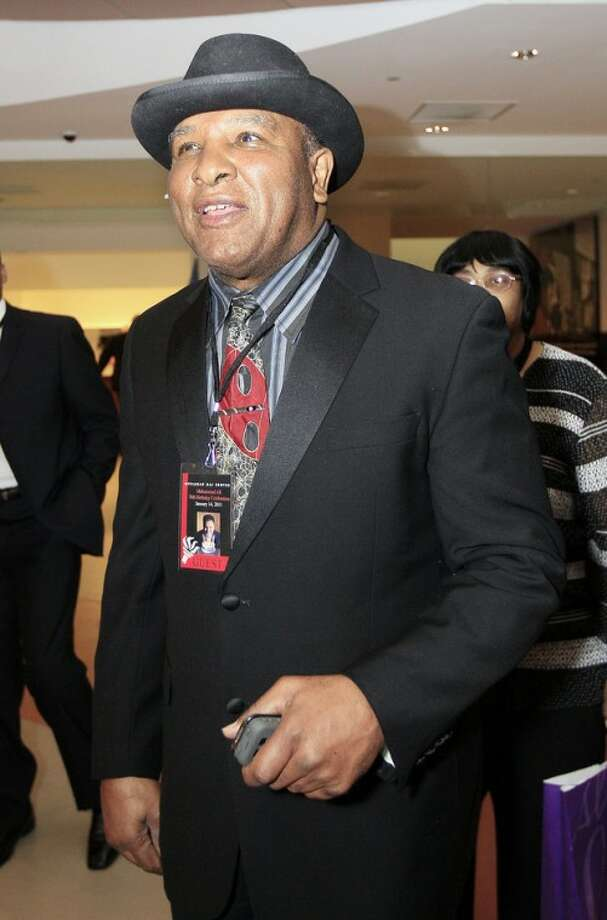Rahaman Ali, brother of boxing great Muhammad Ali, arrives at the Muhammad Ali Center for a birthday celebration for Muhammad Ali on Saturday, Jan. 14, 2012, in Louisville, Ky. Muhammad Ali turns 70 Tuesday. (AP Photo/Mark Humphrey)