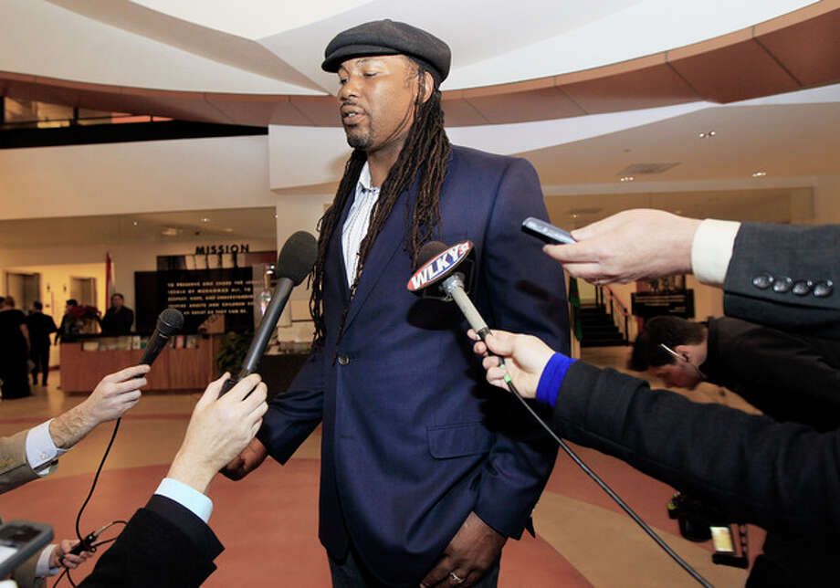Former heavyweight champion Lennox Lewis talks about boxing great Muhammad Ali as he arrives for Ali's birthday celebration at the Muhammad Ali Center on Saturday, Jan. 14, 2012, in Louisville, Ky. Ali turns 70 Tuesday. (AP Photo/Mark Humphrey) / AP
