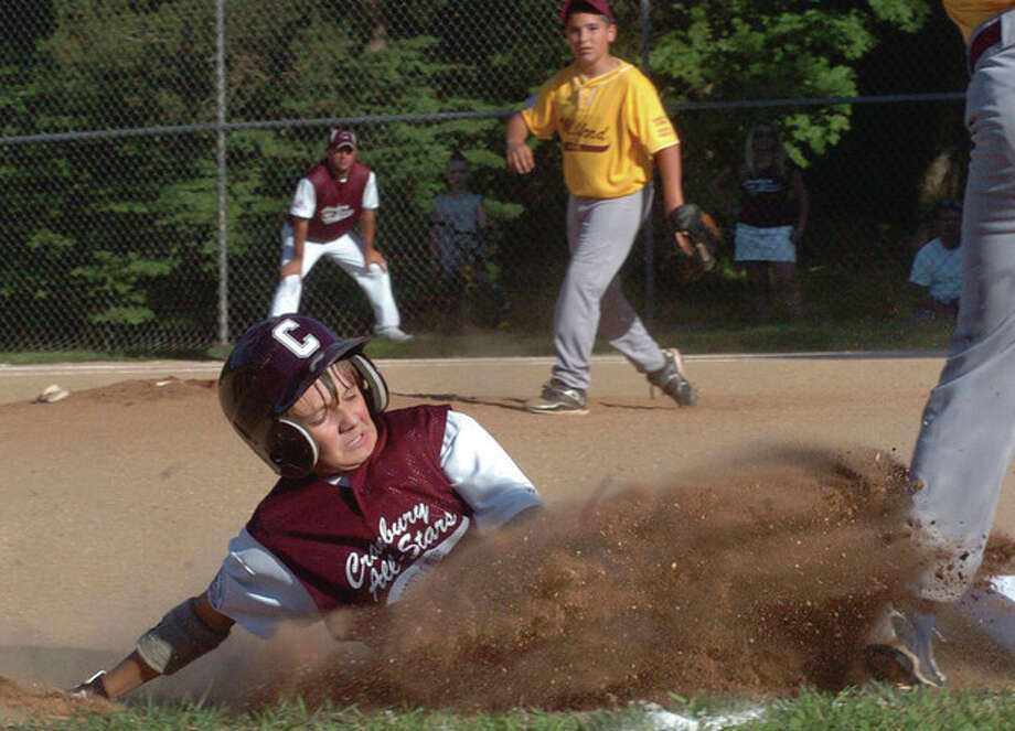 Hour photo/Matthew Vinci Eddie McCabe of the Cranbury Bronco all-stars slides safely into third base during FridayÕs PONY Baseball district tournament game against Milford at Tim Devine Field in Norwalk. It was the opener of a best-of-three series. Norwalk won, 10-9.