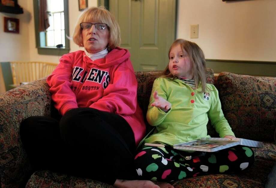 Alannah Shevenell, 9, and her grandmother, Debi Skolas, speak to a reporter at their home in Hollis, Maine, Thursday, Feb. 2, 2012. Alannah returned home Wednesday afternoon, three months after receiving six new organs in a groundbreaking operation. Doctors at Children's Hospital Boston replaced Alannah Shevenell's stomach, liver, spleen, small intestine, pancreas and a portion of her esophagus in October. It's believed to be the first-ever transplant of an esophagus and the largest number of organs transplanted at one time in New England. (AP Photo/Robert F. Bukaty) / AP