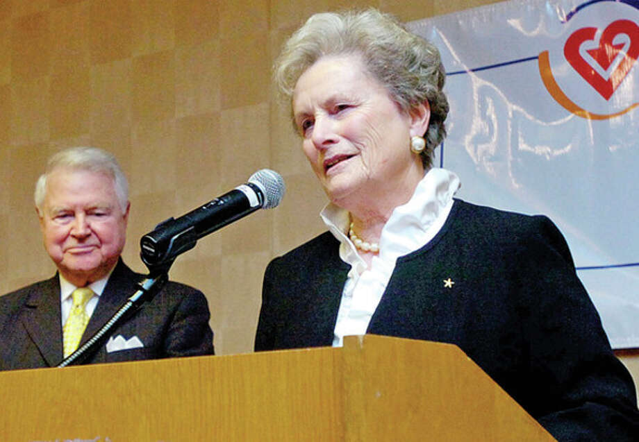 Distiguished Service Award recipients Carol and George Bauer make their acceptance remarks during the Voluntary Action Center's 2011 Volunteer Leadership Breakfast Tuesday morning at Dolce Norwalk. Hour photo / Erik Trautmann / (C)2011, The Hour Newspapers, all rights reserved