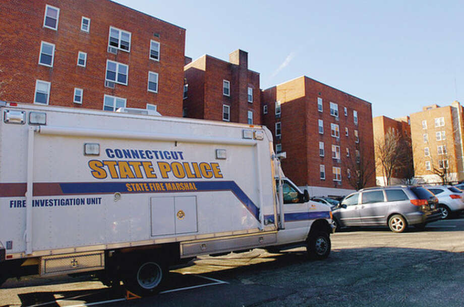Hour photos / Erik Trautmann Above, state police respond to an apartment fire in the Sheffield Ridge Condominium complex at 45 Maple St. in Norwalk early Tuesday morning, sending two women to the hospital with life-threatening injuries. / (C)2011, The Hour Newspapers, all rights reserved