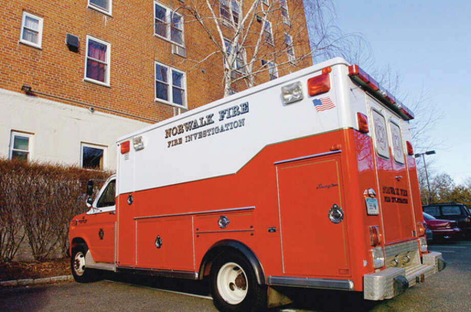 A fire ripped through apartment 4C in the Sheffield condominium complex at 45 Maple St in Norwalk early Tuesday morningsending two women to the hospital wiht life threatening injuries. Hour photo / Erik Trautmann / (C)2011, The Hour Newspapers, all rights reserved